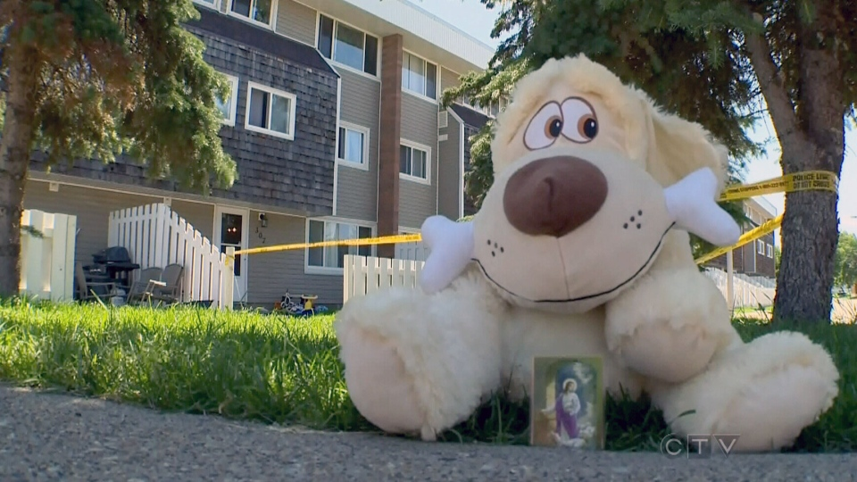 A stuffed animal sits on a sidewalk in memory of Edmonton girl who died after being left in a hot vehicle.