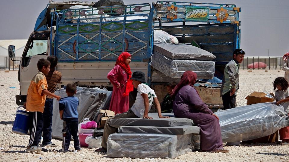 Syrian refugees take down their belongings, on the World Refugee Day, at Zaatari refugee camp, in Mafraq, Jordan, Thursday, June 20, 2013. (AP / Mohammad Hannon)
