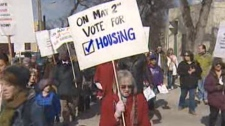 About 150 demonstrators marched through downtown Winnipeg on Tuesday, calling on the federal government to commit more money to low-cost housing.