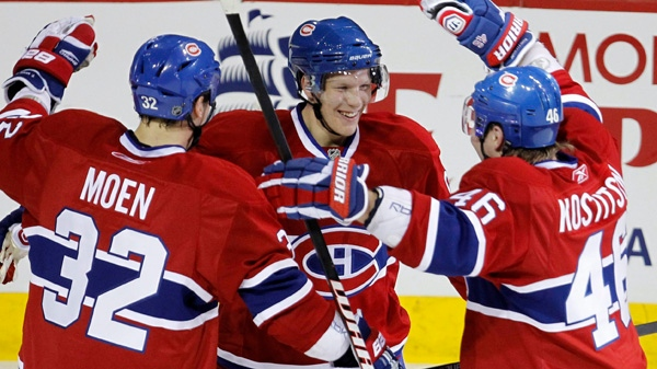 Montreal Canadiens' Lars Eller, centre, celebrates his second goal with teammates Travis Moen, left, and Andrei Kostitsyn as they face the Boston Bruins during first period NHL action Tuesday, March 8, 2011 in Montreal. THE CANADIAN PRESS/Paul Chiasson