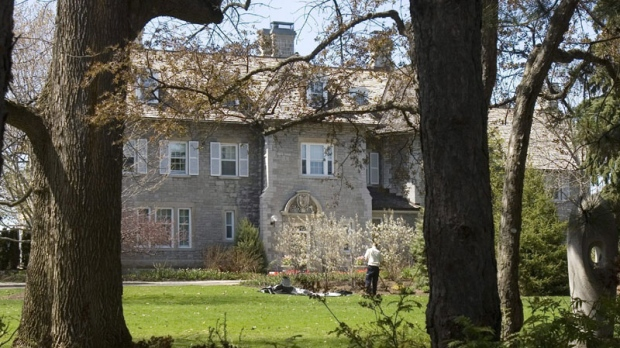 A gardener works on the grounds at the Prime Minister's residence at 24 Sussex Drive in Ottawa, Tuesday May 6, 2008. The stone residence that's supposed to house the prime minister in regal splendour is a drafty, outmoded plumbing nightmare that would take $10 million to fix, says Auditor General Sheila Fraser. (THE CANADIAN PRESS/Tom Hanson)