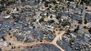 This aerial photo shows Yarnell, Ariz. on Wednesday, July 3, 2013, in the aftermath of the Yarnell Hill Fire that claimed the lives of 19 members of an elite firefighting crew on Sunday. (AP / Tom Tingle)