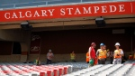 Workers are seen at the Calgary Stampede grounds, Tuesday,  July 2, 2013. (Jeff McIntosh / THE CANADIAN PRESS)