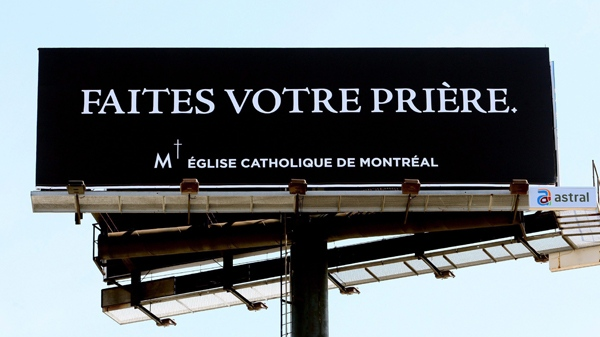 """The Roman Catholic Church has installed a billboard displaying the message """"Say Your Prayers"""" on the southbound lanes of the Turcot Interchange (THE CANADIAN PRESS/Ryan Remiorz)"""