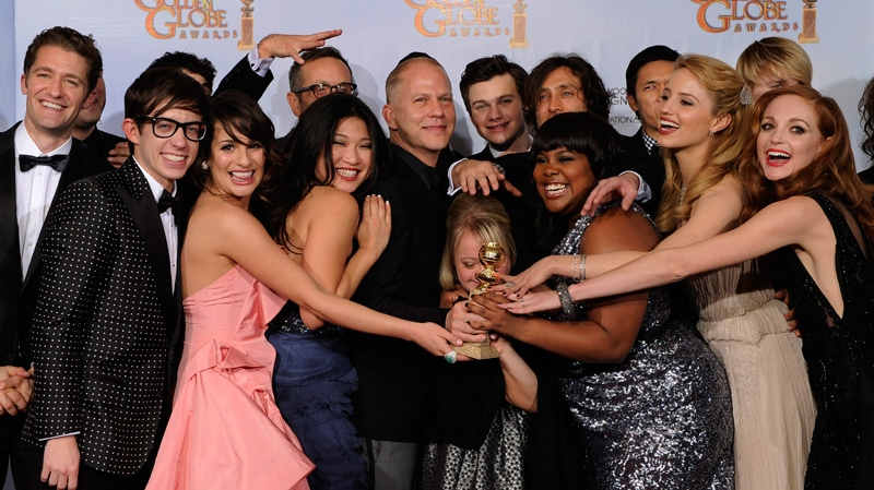 The cast and crew of 'Glee,' pose with the award they won for Best Television Series - Comedy Or Musical at the Golden Globe Awards in Beverly Hills, Calif., Jan. 16, 2011. (AP / Mark J. Terrill)