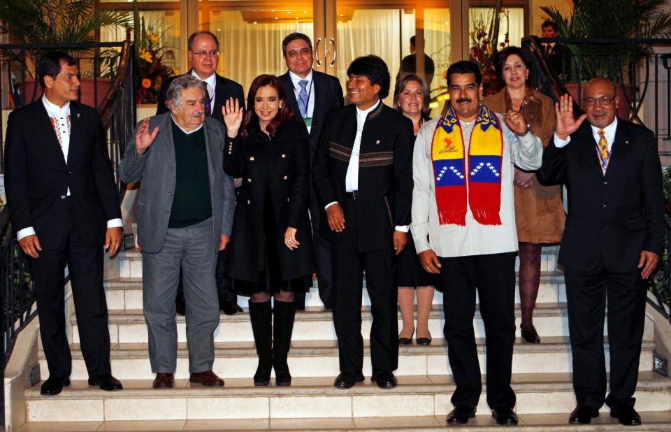 Left to right, Ecuador's President Rafael Correa, Uruguay's President Jose Mujica, Argentina's President Cristina Fernandez, Bolivia's President Evo Morales, Venezuela's President Nicolas Maduro and Suriman's President Desi Bouterse pose for photos in Cochabamba, Bolivia, Thursday, July 4, 2013. (AP / Juan Karita)