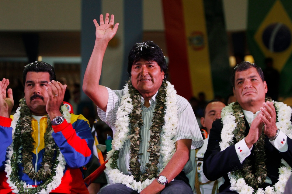 Venezuela's President Nicolas Maduro, left, Ecuador's President Rafael Correa, right, and Bolivia's President Evo Morales acknowledge supporters during a welcome ceremony for presidents attending an extraordinary meeting in Cochabamba, Bolivia, Thursday, July 4, 2013. (AP / Juan Karita)