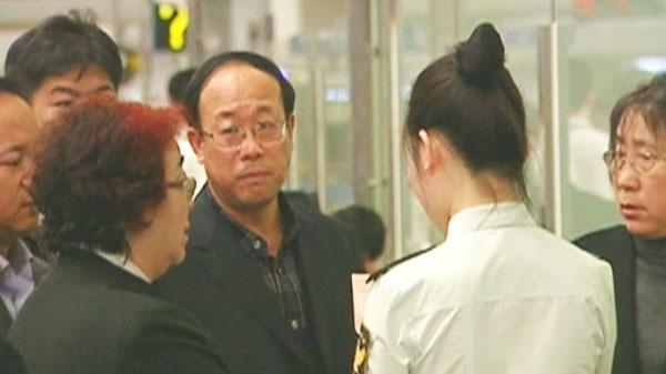 Qian Liu's father, Jianhui Liu, is seen leaving Beijing on flight to Toronto on Wednesday, April 20, 2011.