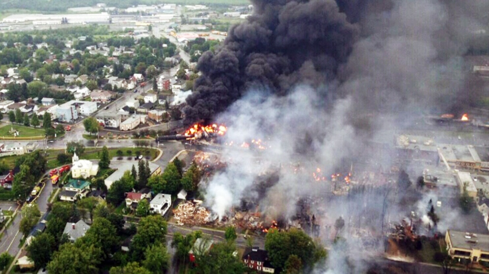 A massive fire sparked by the derailment of a train carrying crude oil is still burning in the eastern Quebec town of Lac-Megantic Saturday, July 6, 2013. (Surete du Quebec)