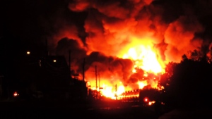 A massive fire sparked by the derailment of a train carrying crude oil burns in Lac-Megantic, Que., on Saturday, July 6, 2013.