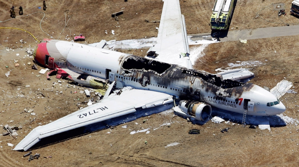 This aerial photo shows the wreckage of the Asiana Flight 214 airplane after it crashed at the San Francisco International Airport in San Francisco, Saturday, July 6, 2013. (AP / Marcio Jose Sanchez)