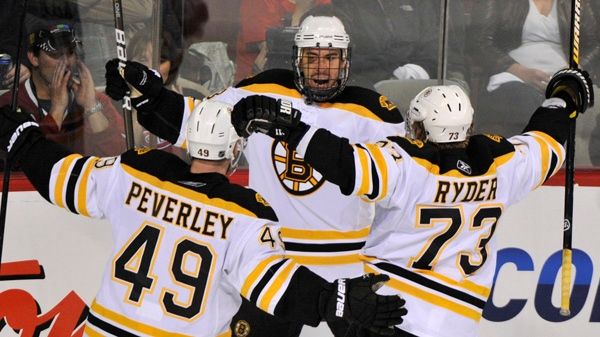 Boston Bruins' Chris Kelly celebrates his goal against the Montreal Canadiens with teammates Rich Peverley and Michael Ryder during third period of Game 4 NHL Stanley Cup playoff hockey action Thursday, April 21, 2011 in Montreal. THE CANADIAN PRESS/Paul Chiasson