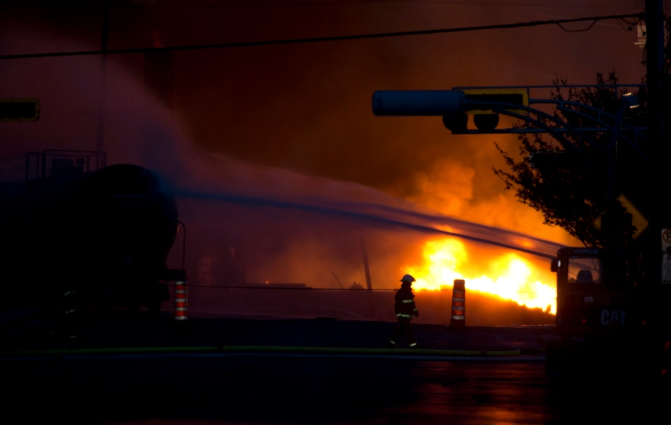Fire keeps burning nearly 24 hours after railway cars that were carrying crude oil derailed in downtown Lac Megantic, Que., on Saturday, July 6, 2013. (The Canadian Press/Paul Chiasson)