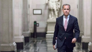 Mark Carney, the new Governor of the Bank of England, walks to a monetary policy committee  briefing on his first day on the job inside the central bank's headquarters in London Monday July 1, 2013. (Jason Alden / THE CANADIAN PRESS)