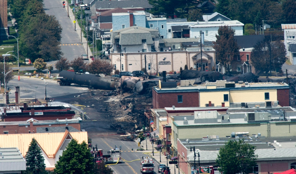 The downtown of Lac-Megantic, Que. is seen the day after a train derailed causing explosions of railway cars carrying crude oil, Sunday, July 7, 2013. (Paul Chiasson / THE CANADIAN PRESS)