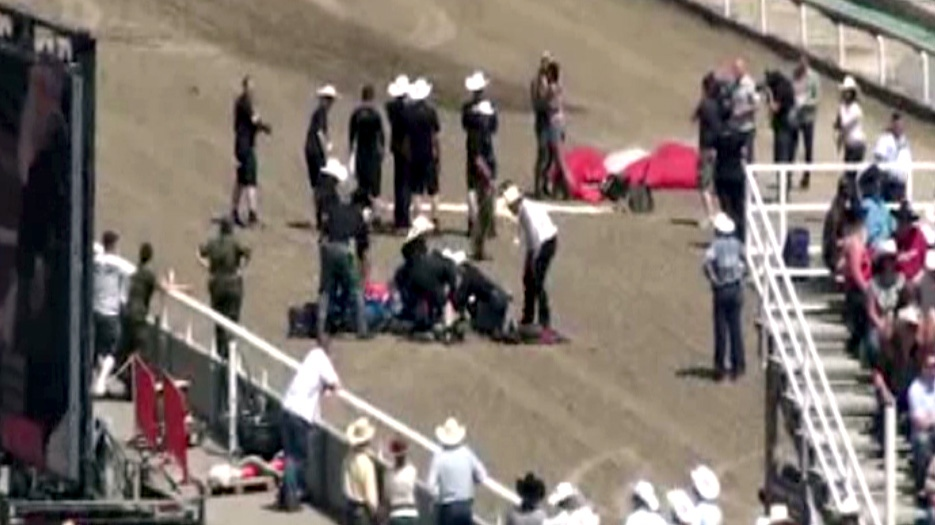 Officials attend to an injured Canadian Forces skydiver at the Calgary Stampede, Sunday, July 7, 2013. (Harold Kehoe / MyNews.CTVNews.ca)