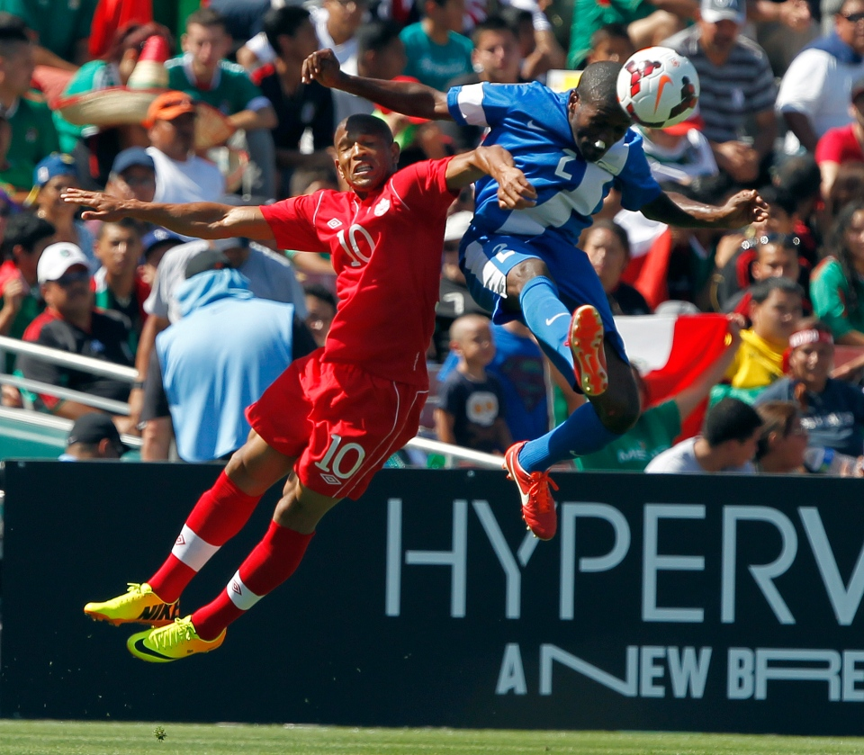 Martinique defender Nicolas Zaire, right, beats Canada midfielder Simeon Jackson, left, to the ball in the second half during a CONCACAF Gold Cup soccer match in Pasadena, Calif., Sunday, July 7, 2013. (AP / Alex Gallardo)