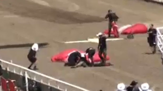 A screen capture from a viewer video shows the aftermath of a skydiving accident involving a member of the Canadian Forces Skyhawks team at the Calgary Stampede on July 7, 2013.