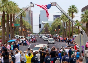 A procession of 19 hearses drives through Phoenix, Sunday, July 7, 2013. (AP / The Arizona Republic, Cheryl Evans)