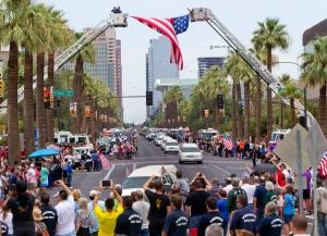 A procession of 19 hearses drives through Phoenix, Sunday, July 7, 2013. (AP / The Arizona Republic, Cheryl Evans)