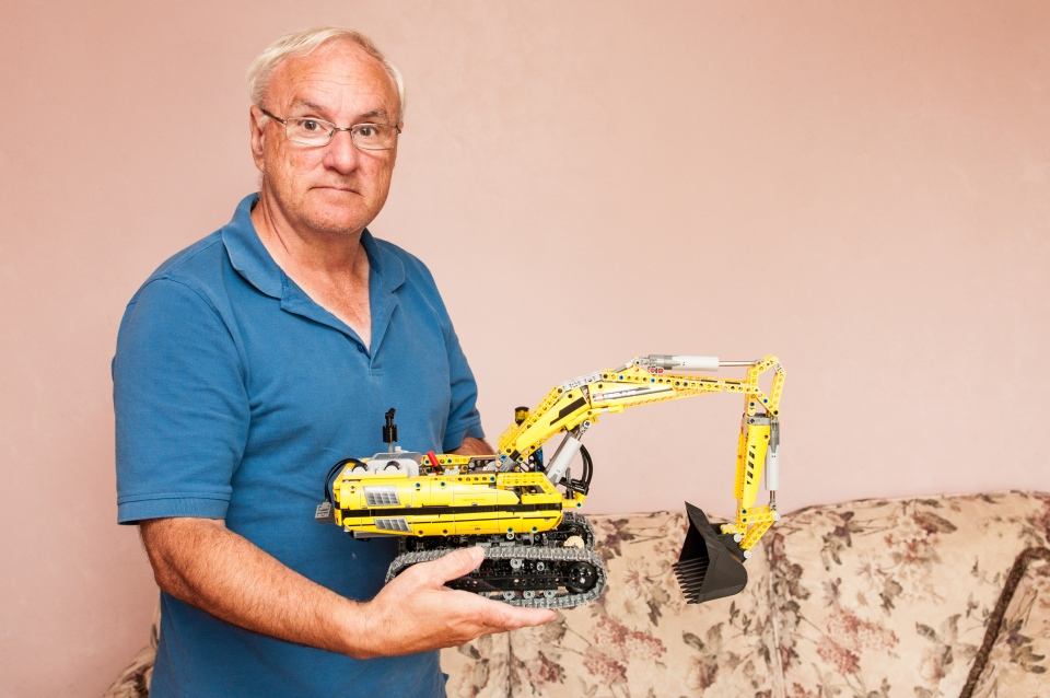 John St-Onge is shown in this supplied image, displaying one of his Lego projects. St-Onge was denied entry to the location over a rule that states all adults must be accompanied by a child.