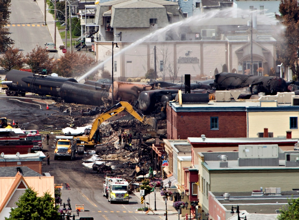 Searchers dig through the rubble for victims of the inferno in Lac-Megantic, Que., Monday, July 8, 2013. (Ryan Remiorz  / THE CANADIAN PRESS)