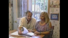 Michelle and Damian Smith look over a new report on the chemicals in their home in London, Ont. on Monday, July 8, 2013.