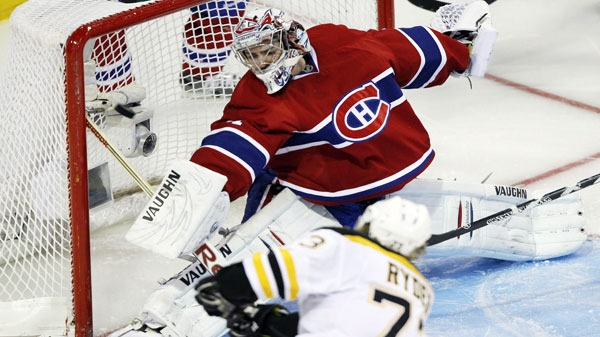 Boston Bruins right wing Michael Ryder (73) scores the winning goal against Montreal Canadiens goalie Carey Price (31) during the first overtime period of game four NHL Stanley Cup playoff hockey action Thursday, April 21, 2011 in Montreal.THE CANADIAN PRESS/Ryan Remiorz