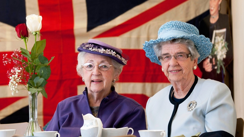 A royal wedding tea at St. Matthews on the Plains Anglican Church in Burlington in advance of Kate Middleton and Prince William's wedding. Ruth Gallagher, left, and Dorothy Mair, right, both of Burlington, at the tea in their finest hats. For Laura LeRose feature. (The Canadian Press / John Rennison)