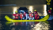 Stranded passengers rescued from flooded Toronto