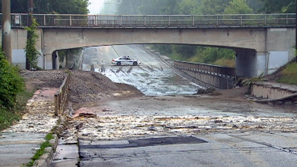 Debris from the flooding litters an area under a bridge on Dixie Road, north of Lake Shore, early Tuesday, July 9, 2013.
