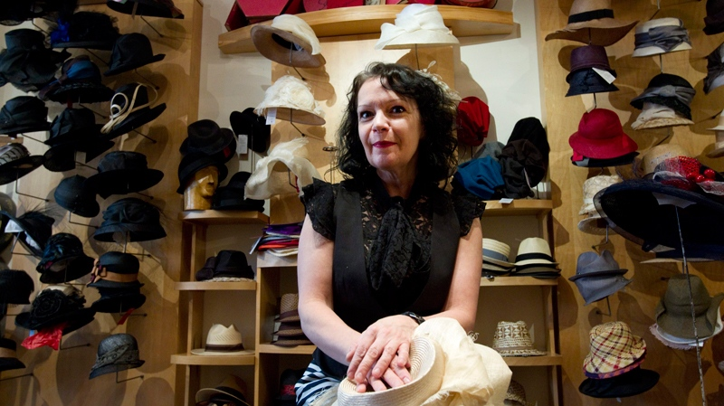 Karyn Gingras, owner and designer of Toronto millinery Lilliput Hats, is surrounded by some of her creations in Toronto on Friday March 11, 2011.(Frank Gunn / THE CANADIAN PRESS)