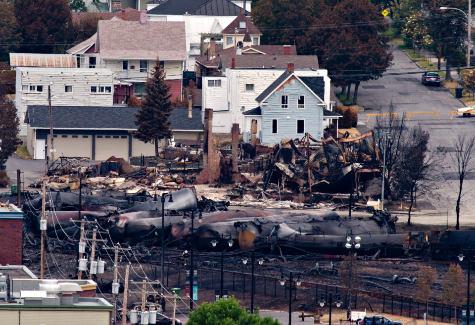 Charred tanker cars are piled up in Lac-Megantic, Que., Tuesday, July 9, 2013, after a train derailed igniting tanker cars carrying crude oil early Saturday. (Jacques Boissinot / THE CANADIAN PRESS)