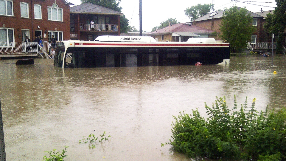 A TTC bus is stranded on a flooded street in Toronto on Monday, July 8, 2013. (Dave Lister / MyNews.CTVNews.ca)