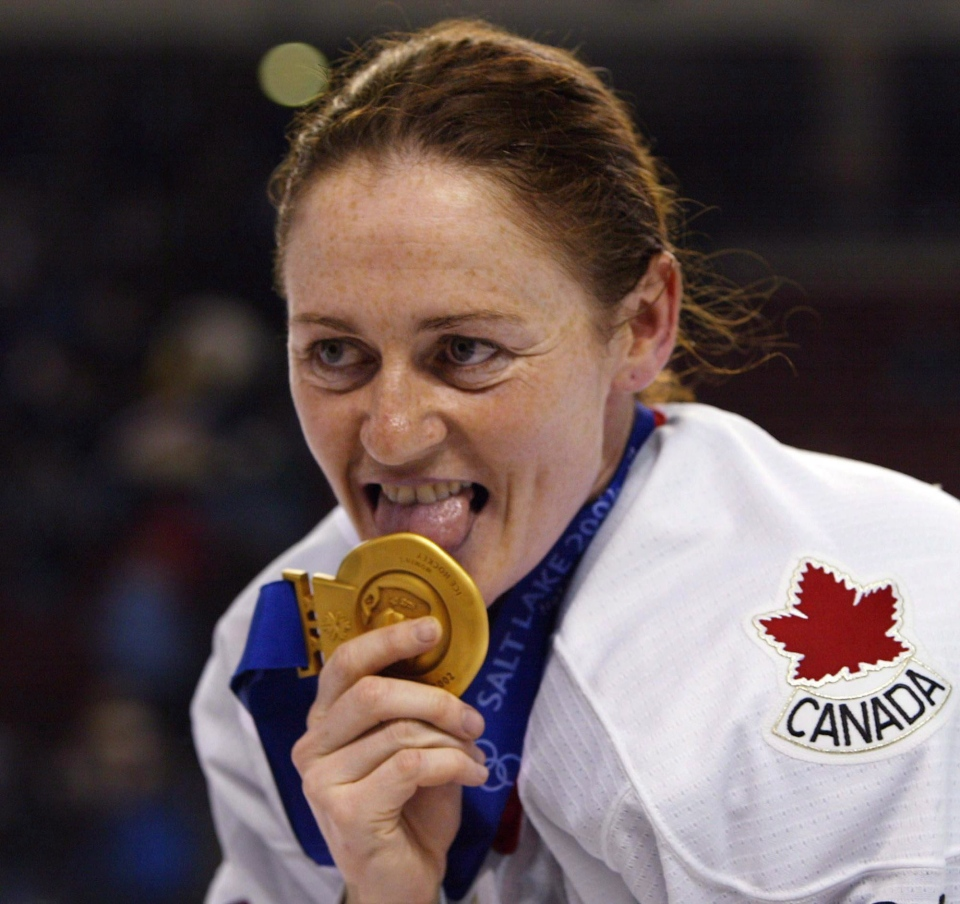Canadian women's hockey team member Geraldine Heaney licks her gold medal after their win over the United States at the XIX Olympic Winter Games in Salt ... - image
