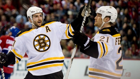 Boston Bruins' Andrew Ference (21) celebrates with teammate Patrice Bergeron, after scoring against the Montreal Canadiens during second period Game 4 NHL Stanley Cup playoff hockey action in Montreal, Thursday, April 21, 2011. THE CANADIAN PRESS/Graham Hughes