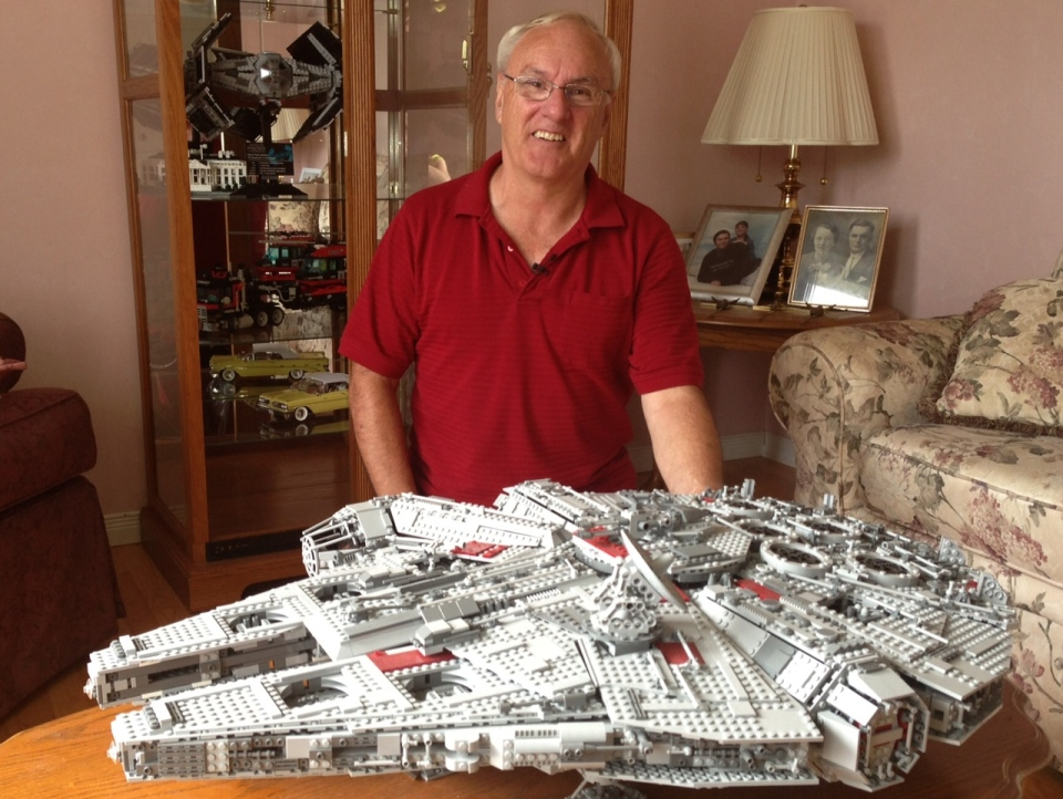 "Self-proclaimed ""Lego fanatic"" John St-Onge poses with his set depicting the Millenium Falcon from Star Wars in Windsor, Ont., on Tuesday, July 9, 2013. (Sacha Long / CTV Windsor)"