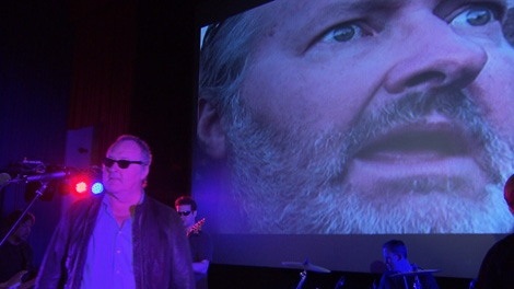 Randy Quaid performs his latest song, 'Mr. D.A. Man,' at the Rio Theatre in East Vancouver. April 22, 2011. (CTV)