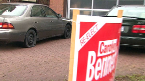 A flat tire is seen in front of a Liberal campaign sign in the riding of St. Paul's, Saturday, April 23, 2011.