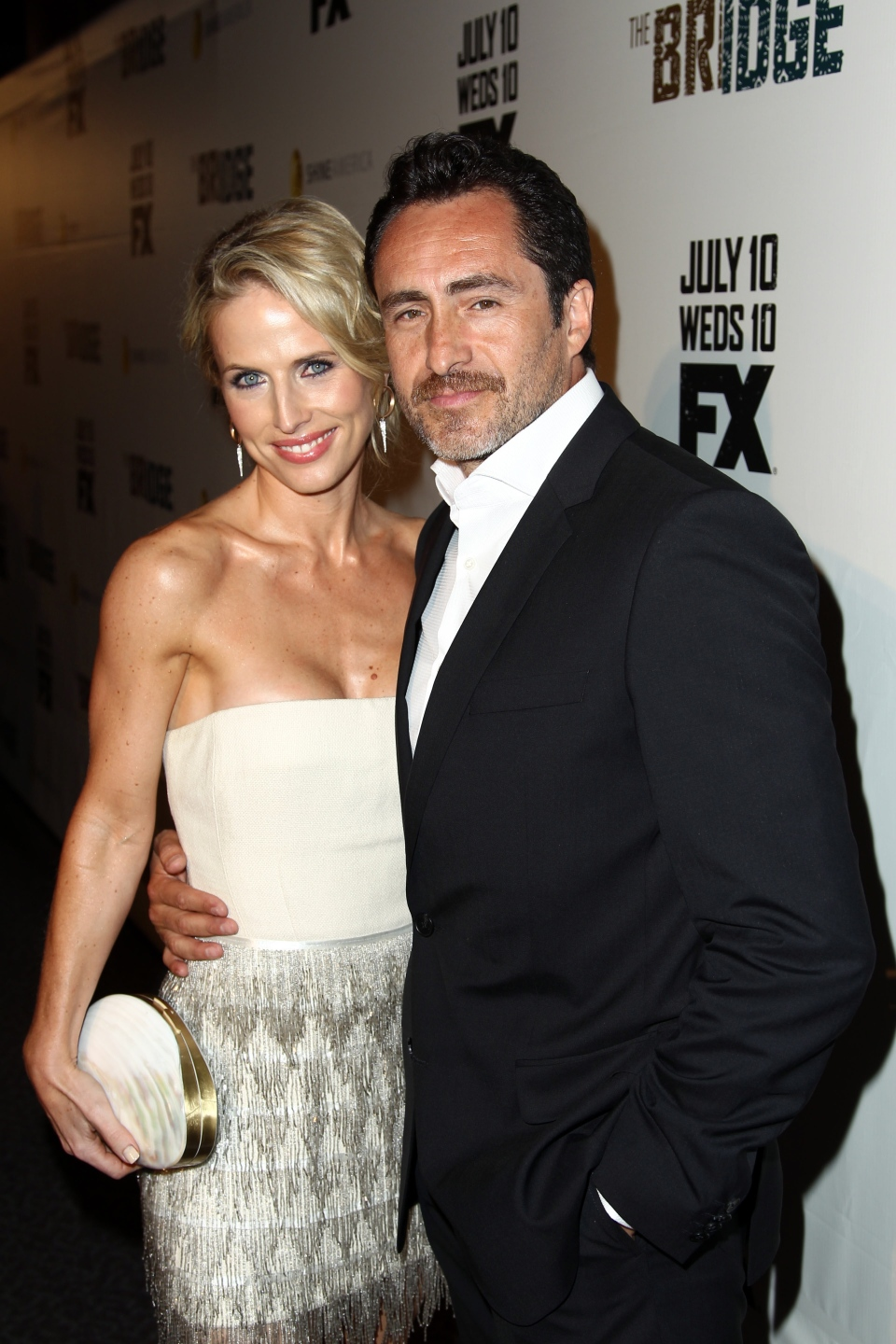 Demian Bichir, right, and Stefanie Sherk arrive at the premiere screening of 'The Bridge' at the DGA Theatre in Los Angeles on Monday, July 8, 2013. (Matt Sayles/Invision)
