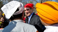 Liberal Leader Michael Ignatieff makes his way through the crowd at a Khalsa Day celebration Sunday, April 24, 2011 in Toronto. (Paul Chiasson / THE CANADIAN PRESS)