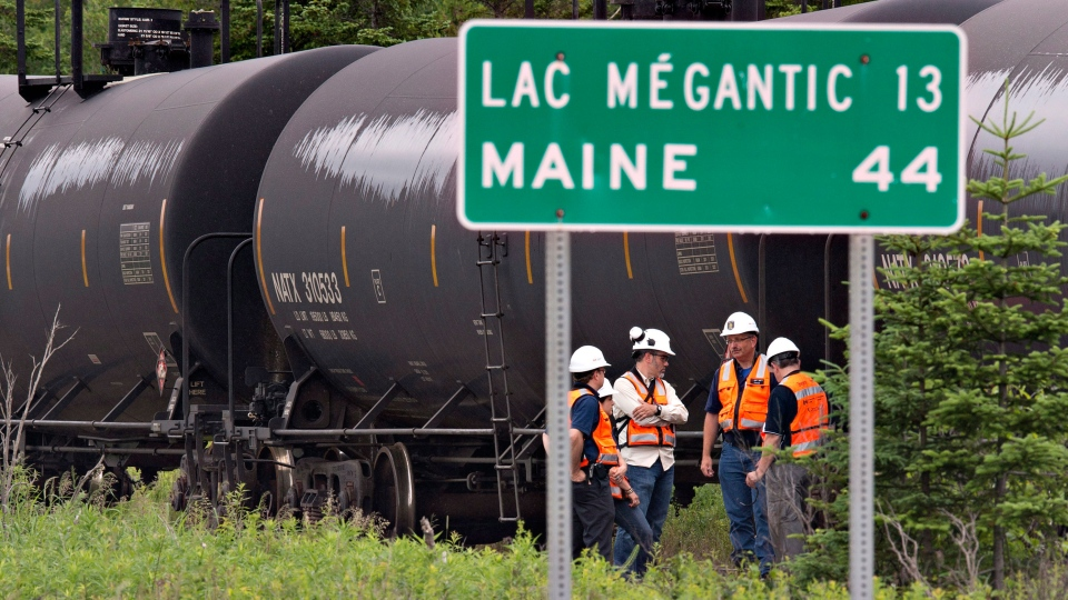 Environment Canada emergency inspectors check on nine MMA tanker cars that remain on the tracks in Nantes, Que., Wednesday, July 10, 2013. (Jacques Boissinot / THE CANADIAN PRESS)