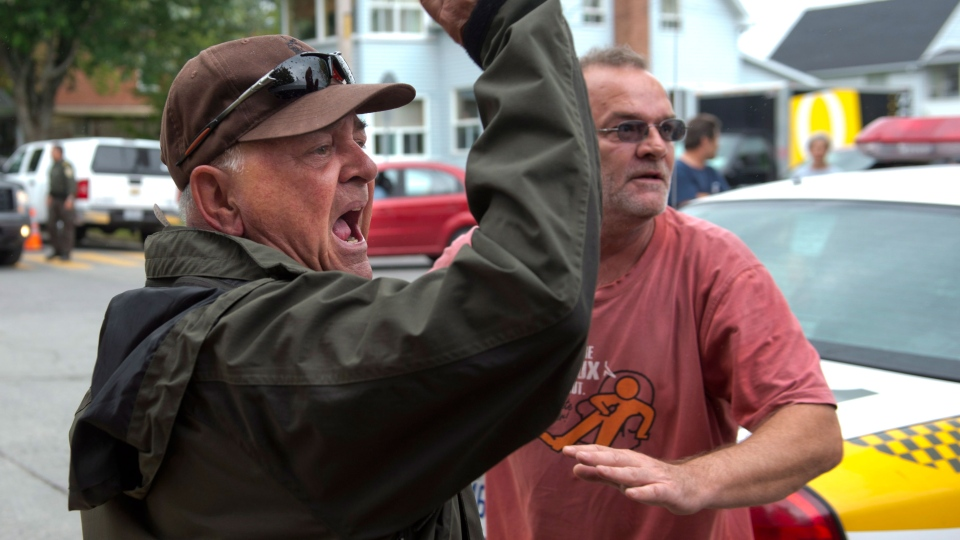 Residents yells during a news conference by Rail World Inc. president Ed Burkhardt in Lac-Megantic, Que., on Wednesday, July 10, 2013. (Paul Chiasson / THE CANADIAN PRESS)
