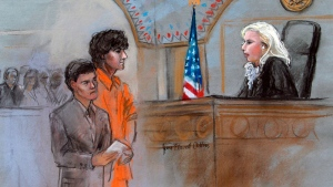 This courtroom sketch depicts Boston Marathon bombing suspect Dzhokhar Tsarnaev standing with his lawyer Miriam Conrad, left, before Magistrate Judge Marianne Bowler, right, during his arraignment in federal court Wednesday, July 10, 2013 in Boston. (AP / Jane Flavell Collins)