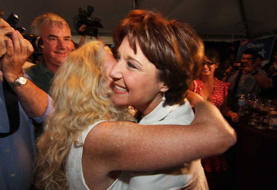 British Columbia Premier Christy Clark gets a hug from a supporter before taking the stage to deliver her victory speech after winning a byelection in Kelowna, B.C., on Wednesday, July 10, 2013. (Chris Stanford / THE CANADIAN PRESS)