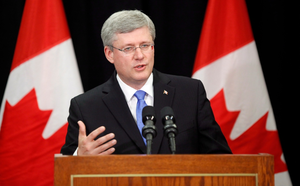 Prime Minister Stephen Harper makes a statement regarding the explosion that occurred in Quebec during a news conference in Calgary, Saturday, July 6, 2013. (Jeff McIntosh / THE CANADIAN PRESS)