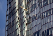 Greenpeace activists scale building