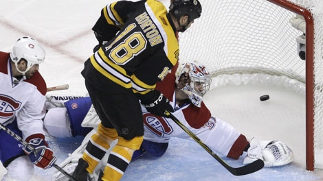 Boston Bruins right wing Nathan Norton (18) beats Montreal Canadiens goalie Carey Price for the game-winning goal during the second overtime period in Game 5 of a first-round NHL Stanley Cup hockey playoff series in Boston, Saturday, April 23, 2011. The Bruins won 3-2, taking a 3-2 lead in the series. (AP Photo/Charles Krupa)