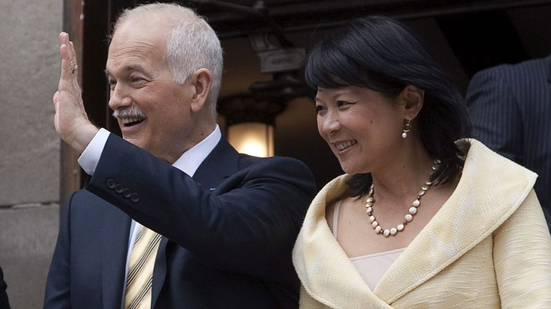NDP Leader Jack Layton and his wife Olivia Chow head from Easter service at Runnymede United Church in Toronto on Sunday, April 24, 2011. The federal election will be held on May 2. (THE CANADIAN PRESS/Andrew Vaughan)
