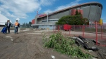 Flood debris is shown outside the Saddledome, home of the NHL's Calgary Flames, in downtown Calgary, Alta., Sunday, June 23, 2013. (CP / Jonathan Hayward)